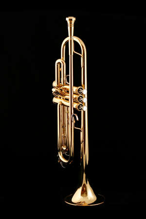music instrument: Gold lacquer trumpet with mouthpiece on black Stock Photo