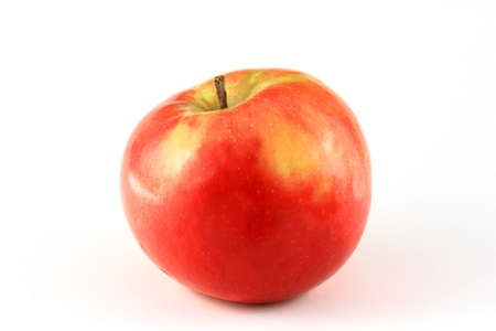 Single red apple isolated on white with a bit of shadow Stock Photo