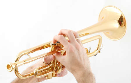 fingering: Trumpet players hands and his golden trumpet