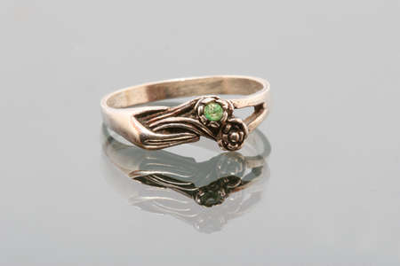 weddingrings: Silver ring close-up on a glass surface with a hand and roses engraved