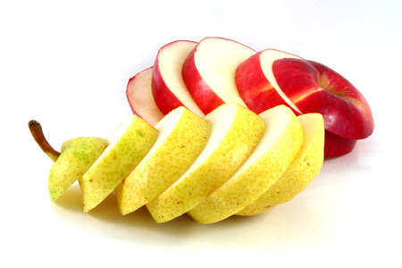 Red apple and yellow ripe pear cut in sections isolated on white