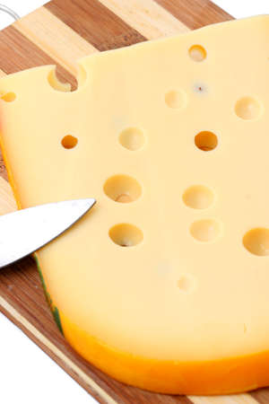 orifice: Cheese cut in slices on a wooden plate Stock Photo