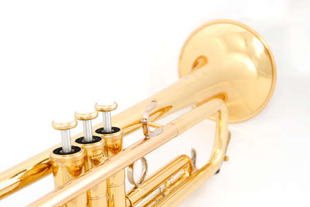music instrument: Gold lacquer trumpet closeup on valves