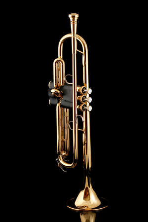 brass: Gold lacquer trumpet with mouthpiece on black Stock Photo
