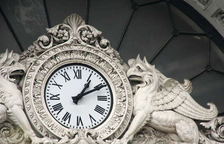 arhitecture: Old medieval clock in Italy, Milano Stock Photo