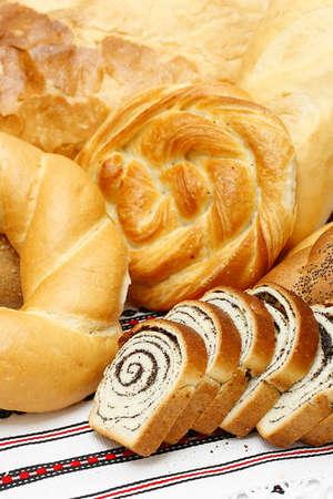 baton: Bread, loaf, cake, baton, crescent on white  Stock Photo