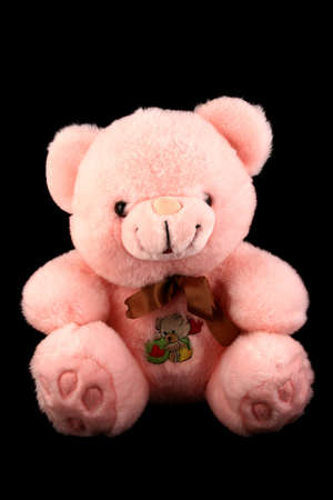 pink teddy bear: Pink teddy bear toy isolated on black