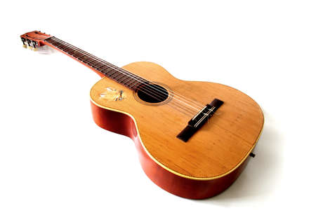 Old acoustic guitar isolated on a white  Stock Photo