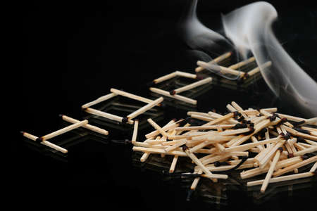 pyromania: Extincted matches on black as a hope concept Stock Photo