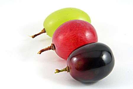 diferent: Three grape berry in diferent colors isolated on white Stock Photo
