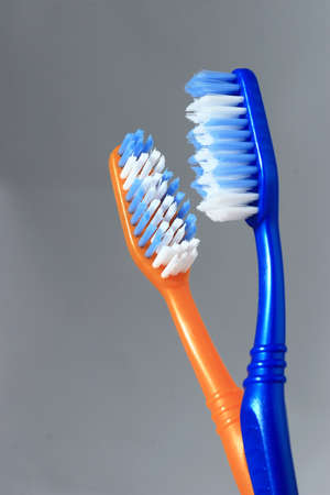 meant: Two tooth brushes close up in a glass