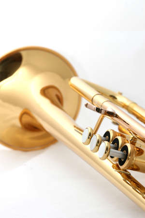 Gold lacquer trumpet close up on white