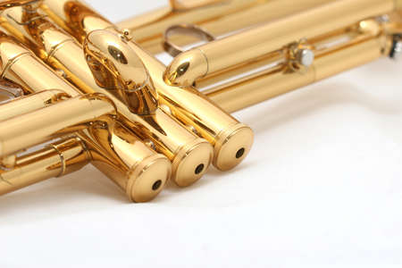 brass: gold lacquer trumpet parts on white Stock Photo