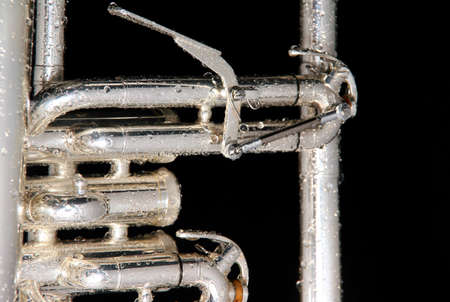 flugelhorn: Details of a wet fluegelhorn on black with water drops on it