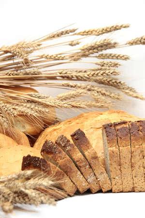 crescent: Bread, loaf, cake, baton, crescent on white  Stock Photo