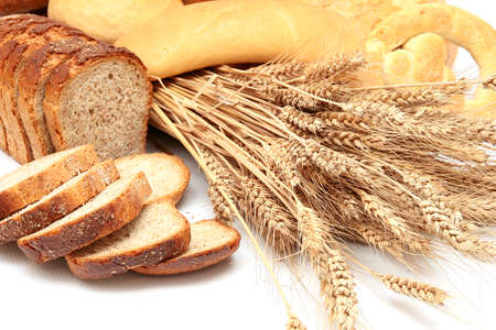Bread, loaf, cake, baton, crescent on white  with cereals