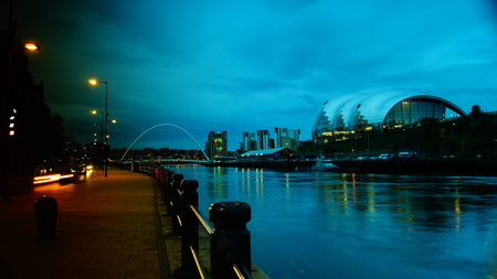 View of Newcastle at dusk, under the bridge