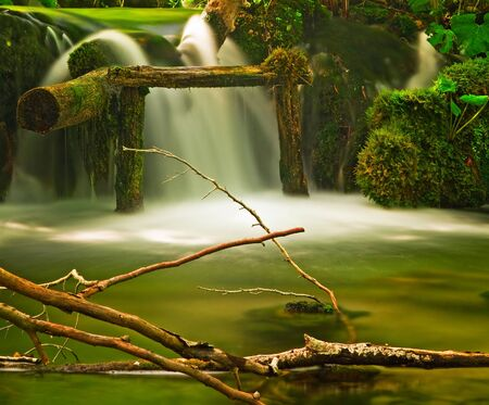 Nice waterfall in the forest  photo