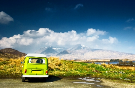 spring holiday: Minibus in the mountains  Stock Photo