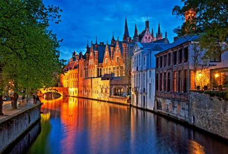 benelux: Night shot of historic medieval buildings along a canal in Bruges, Belgium