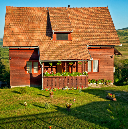 Wooden house with flowers