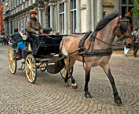Horse-driven cab in Bruges, Belgium Editorial
