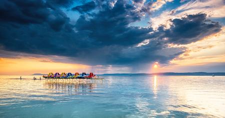 Colorful sunset over lake Balaton Standard-Bild