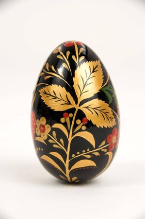 Black easter egg with gold figure.