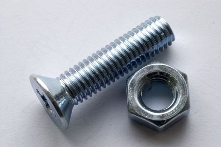 The large bolts and screws on a white background.
