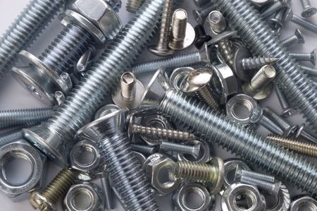 The large and small bolts and screws on a white background.