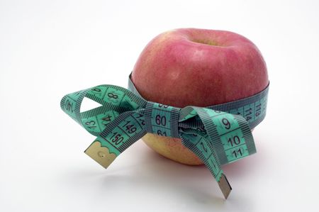 Red Apple with measuring tape.