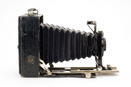 The old photographic chamber with a lens of furs on a white background.