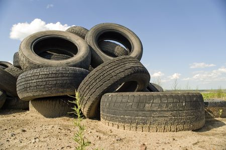 stockpiling: A lot of Wheel Tires dumped in a landfill. Stock Photo