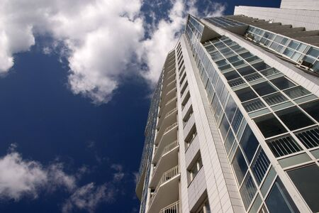 Modern urban building. Glass balconies.