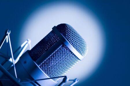 Microphone in studio. Dark blue light.