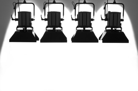 Four  searchlights on a white background. Banque d'images