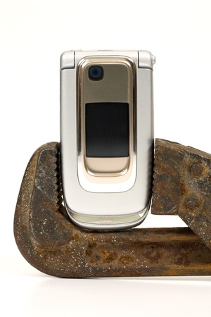 communicative: Old rusty spanner and modern telephone.