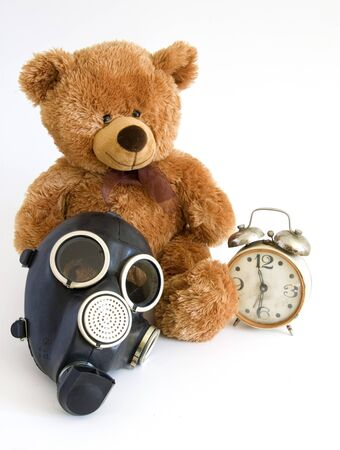 The Nursery toy, gas mask, old watch on white background. Stock Photo