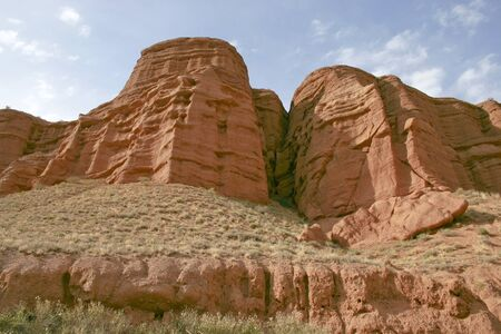 Red mountains on a background of the sky. Stock Photo