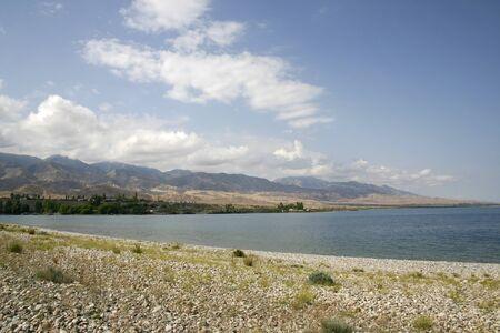 Stone coast of lake.