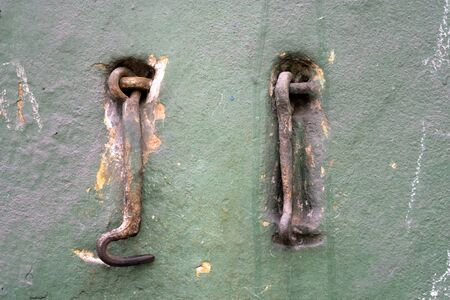 Two old metal hooks.