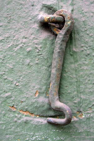 Old wall with a metal hook.