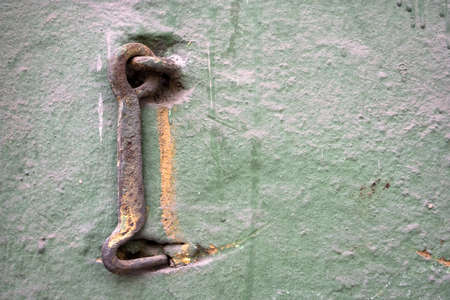 Old wall with a metal hook. Stock Photo - 13696550