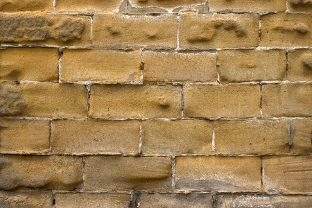 Old wall of a yellow brick. Stock Photo