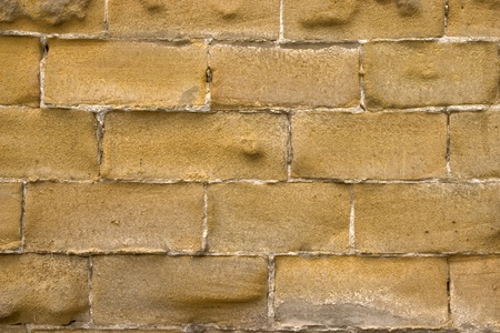 Old wall of a yellow brick. Banque d'images