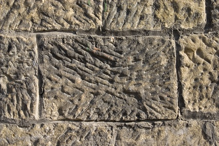 Old wall from a grey stone