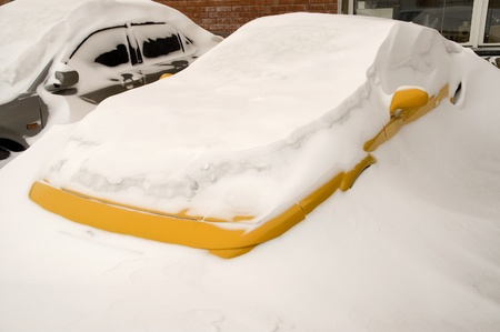 Cars buried deep in Snow Banks  Stock Photo