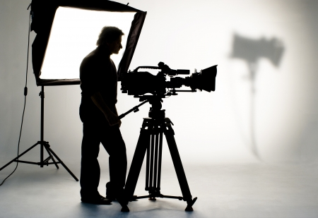 video shooting: Cameraman silhouette and cameras.