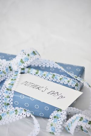 beautifully wrapped: Beautifully wrapped gift for mother s day Stock Photo