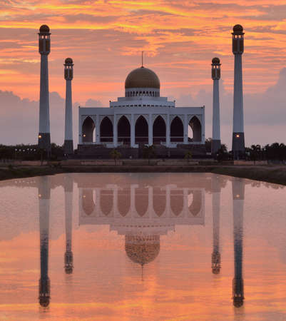 Mosque in songkhla thailand on sunset and reflex with water photo